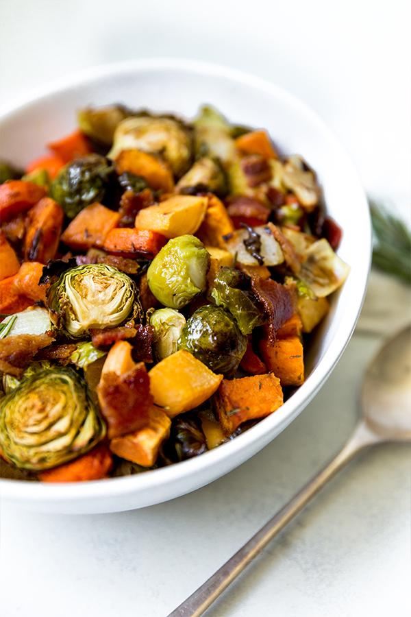 white serving bowl of harvest vegetable hash