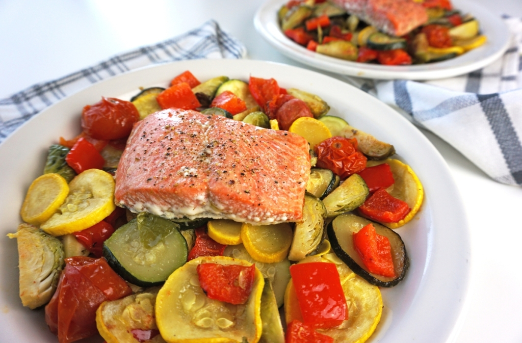 salmon and vegetable dinner served on two white plates