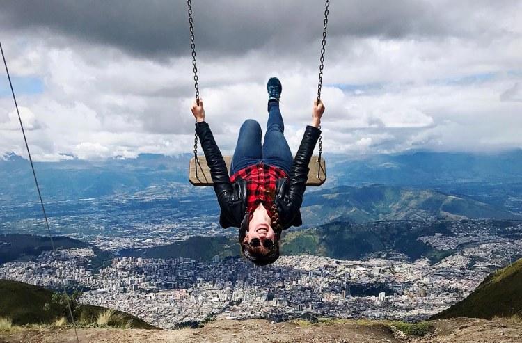 ellen jaworski on a swing overlooking quito ecuador