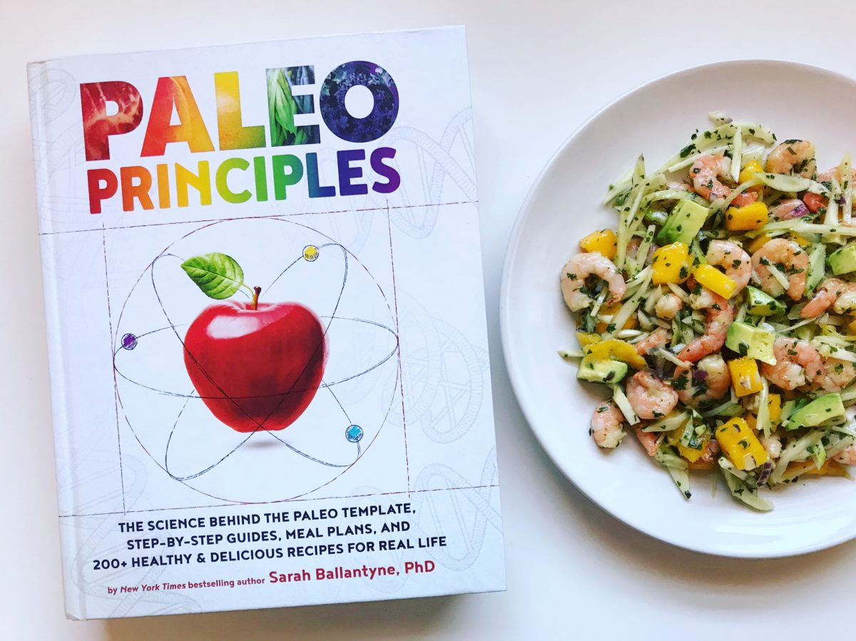 Paleo Principles Book beside Shrimp Salad on a plate