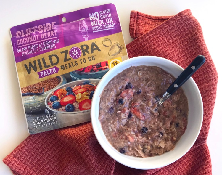 wild zora paleo meals to go cliffside coconut berry package next to a white bowl