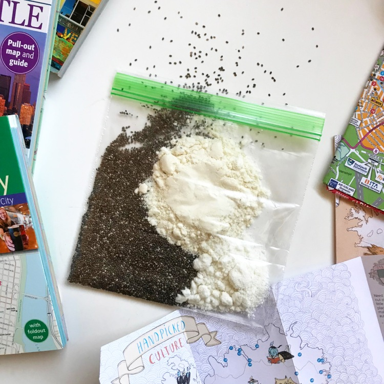 chia seeds coconut milk powder whey protein powder in a ziplock bag surrounded by maps