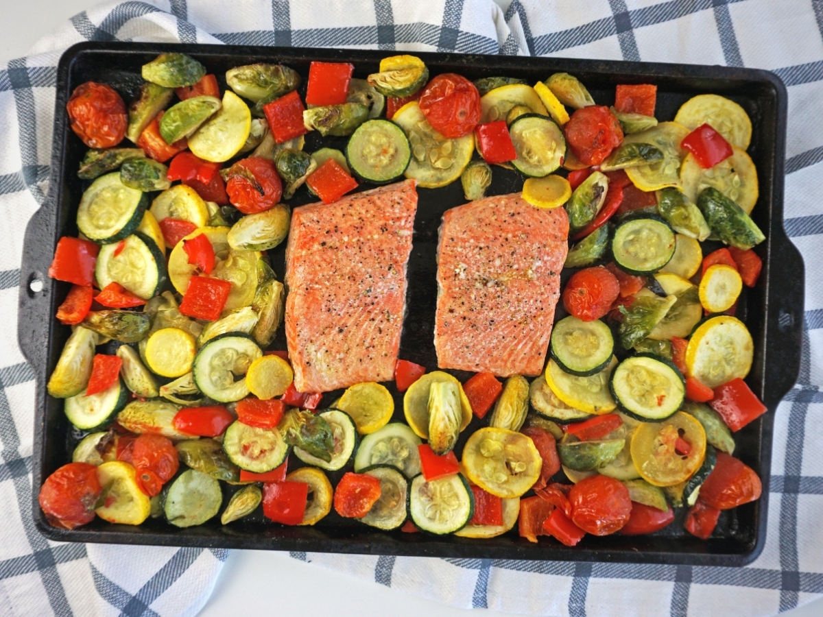 salmon sheet pan dinner on a blue and white checkered dish towel