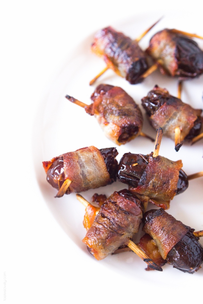 white plate of bacon wrapped dates