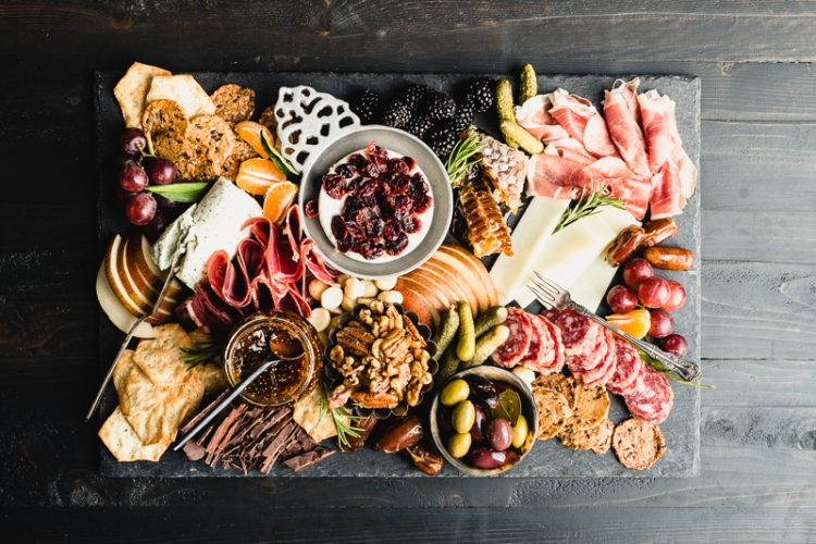 gluten-free charcuterie board with meat crackers cheese and fruit